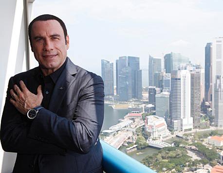 john travolta prend les oscars Breitling réplique